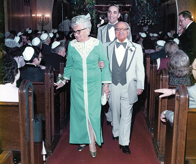 At a family wedding, Bob Levine escorts his parents down the aisle.