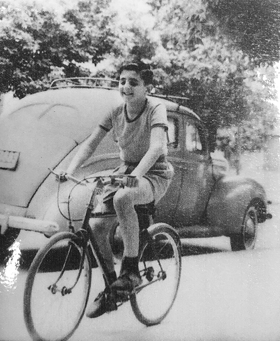 Young Alberto Zeilicovich rides his bike in Buenos Aires.