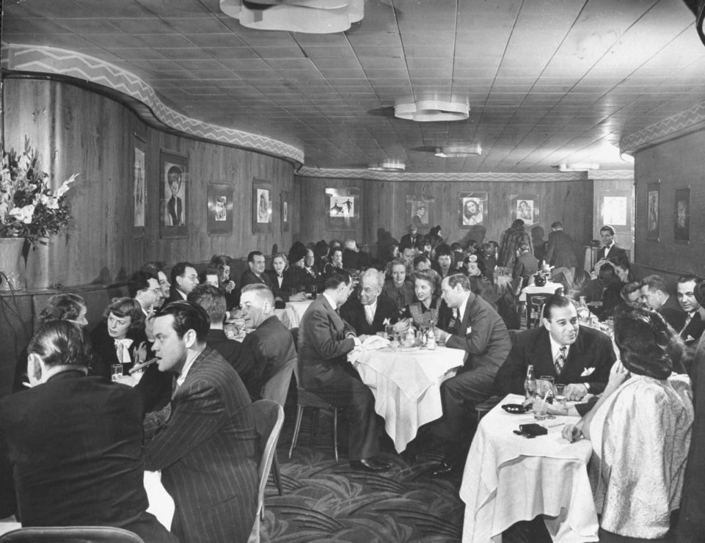In 1944, this photograph of the Stork Club ran in Life magazine. Leonard Lyons, at left at the center table, sits in a group that includes the club's owner, Sherman Billingsley. Orson Welles, in pinstripes, apparently biting a cigar, is at the front left table.