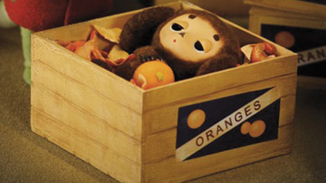 Cheburashka arrives in an orange crate.