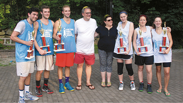 Ron and Diane Strobel are surrounded by the winners of last year's tournament.