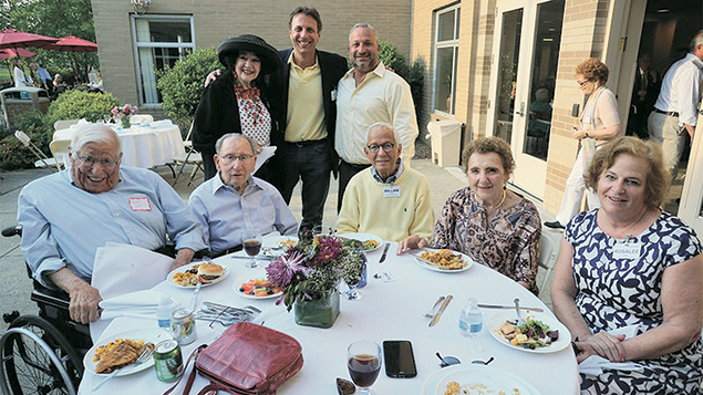 Board membersm standing from left, Dr. Sandra Gold, Jay Nadel, with Brad Ruder. Seated, Dr. Arnold Gold, left, with honorary Jewish Home Family board chair Norman Seiden and board members William Lippman, Elaine Adler, and Rosalee Keech. (Photos Courtesy Jewish Home Family)