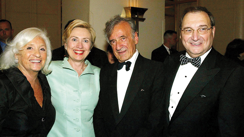 Elie Wiesel and his wife, Marion, Abe Foxman, and Hillary Clinton stand together at Mr. Wiesel's birthday celebration. (ADL)