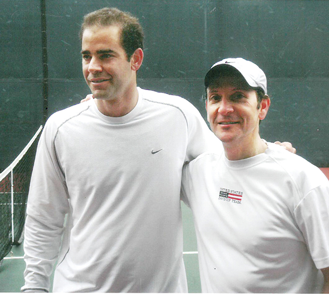 A serious player and fan, here Ben Doller stands with tennis great Pete Sampras.