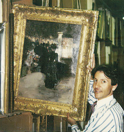 A young Ben Doller, as a Sotheby's cataloguer, in the early 1980s, holds a work by the American painter Frederick Childe Hassam.