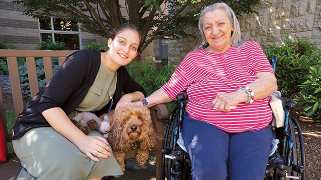 Shana Horn and Rosie bring comfort to a resident of the Jewish Home at Rockleigh.