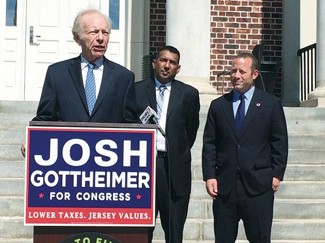 Former Senator Joseph Lieberman of Connecticut endorses Josh Gottheimer, right, on the steps of Teaneck City Hall as Mayor Mohammed Hameeduddin, also a supporter, looks on.