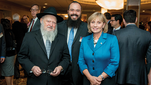 From left, Rabbi Moshe Herson, the dean of the Rabbinical College of America in Morristown, and Rabbi Shalom Lubin, the founder of the Jewish Law Symposium, stand next to New Jersey's lieutenant governor, Kim Guadagno.