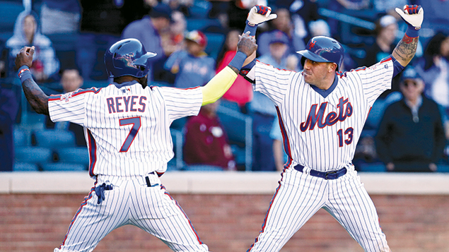 Jose Reyes, left, celebrates with teammate Asdrubal Cabrera during a game against the Philadelphia Phillies at Citi Field in New York on September 25. (Adam Hunger/Getty Images)