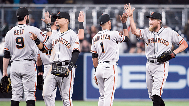 San Francisco Giants players, including Hunter Pence, right, celebrate a win against the Padres at Petco Park in San Diego on September 22. (Denis Poroy/Getty Images)