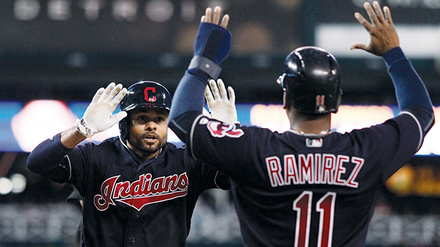 Coco Crisp, left, celebrates with Cleveland teammate Jose Ramirez in a game against the Detroit Tigers at Comerica Park in Detroit on September 26. (Duane Burleson/Getty Images)