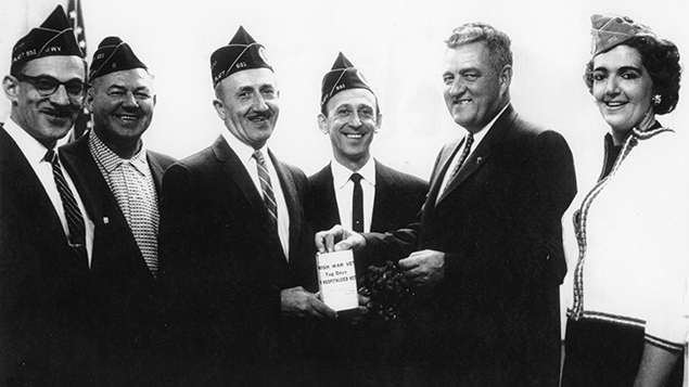 In 1962, a local politician , second from right, with Jewish war veterans.