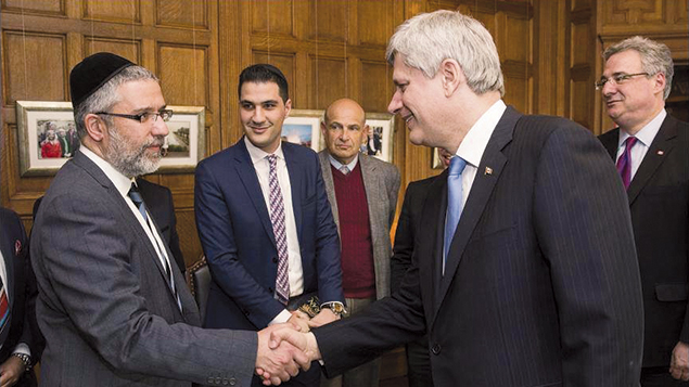 Rabbi Ilan Acoca greets former Canadian Prime Minister Stephen Harper. Rabbi Acoca served a Vancouver congregation for 17 years.