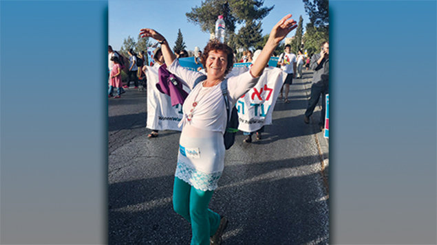 A marcher celebrates in the Women Wage Peace walk to Jerusalem. (Women Wage Peace)