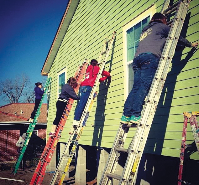 BCHSJS students do hands-on construction work at a Habitat for Humanity home in New Orleans.