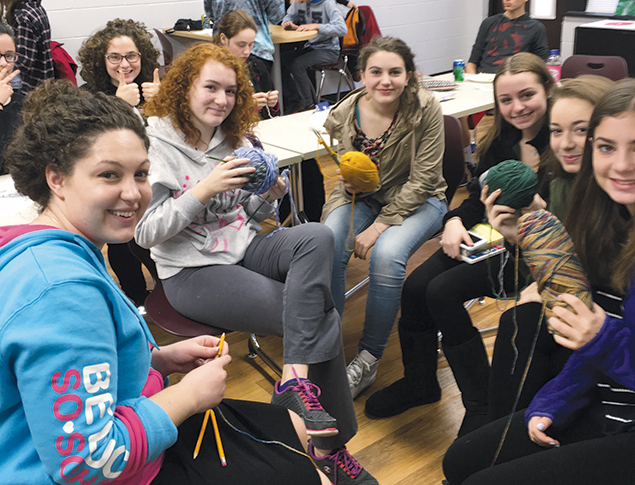 Students at Bergen County High School of Jewish Studies knit together.