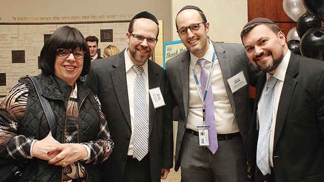Laurette Rothwachs; Rabbi Rothwachs; Jordan Silvestri, the director of Sinai Shalem High School at Heichal HaTorah in Teaneck, and Heichal HaTorah's rosh yeshiva and dean, Rabbi Aryeh Stechler.(Photos courtesy Sinai Schools)