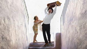 Eleanor Reissa as Sarach tries to restrain her husband Yankel, played by Shane Baker. Ronald L. Glassman
