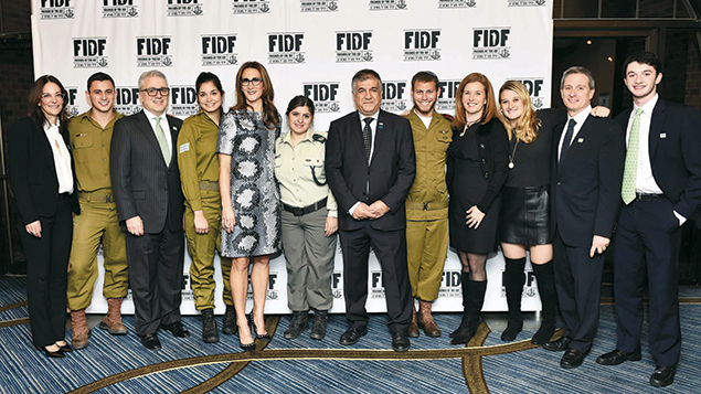 FIDF supporter Rona Anhalt, left; IDF Lone Soldier Sgt. Ari of West Orange; Saul Scherl of Englewood; FIDF Impact! Scholarship recipient Sgt. Rotem Rokach; Jodi Scherl; FIDF Impact! Scholarship recipient Israel Border Police Sgt. Rada Matatov; FIDF National Director/ CEO Maj. Gen. (Res.) Meir Klifi-Amir; IDF Lone Soldier Sgt. Toren of Livingston; and Rachel, Jenny, Zev, and Sam Scherl of Englewood. (Photos courtesy FIDF)