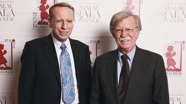 Former U.N. ambassador John Bolton, right, joins Steven Morey Greenberg at the Bnos Menachem dinner. (Photo courtesy of Ell Tee Photo)