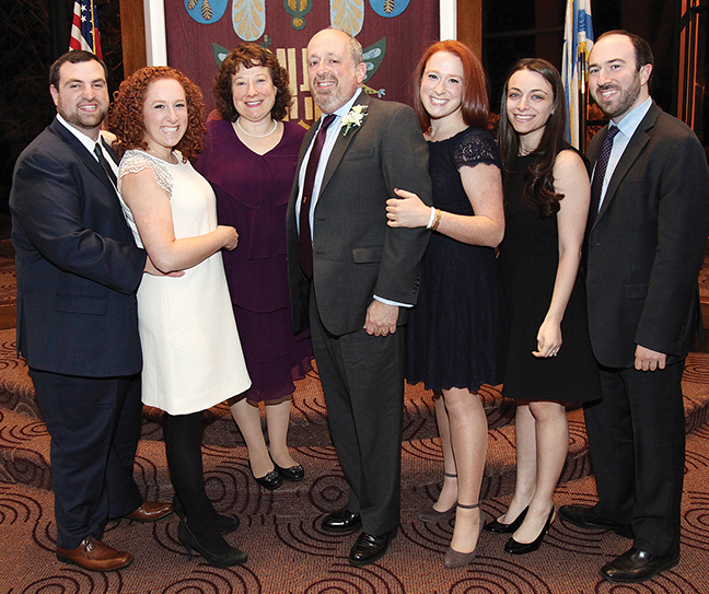 Rabbi Resnick, in the center, is surrounded by his family; from left, son-in-law Elan Sherman and his new bride, Rena; Martha; Dori; and Alana Pellerito and her fiance, Joey.