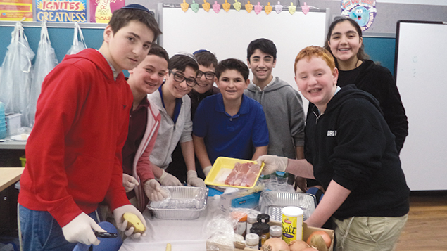 Students prepare to cook Indian food as part of Moriah Reads Day.
