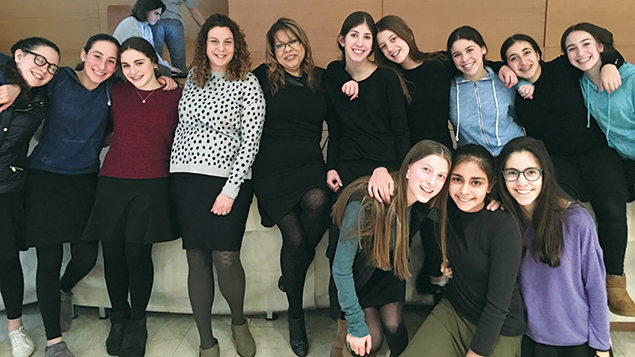 Teachers Elizabeth Zimmer and Rachel Schwartz surrounded by some of their students.