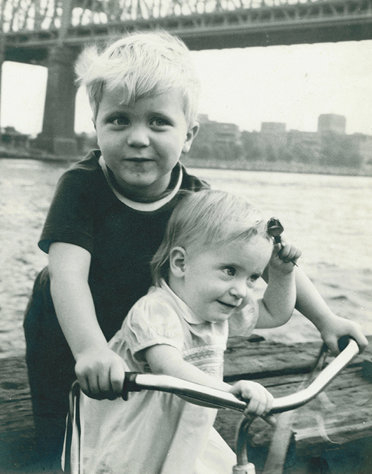 Two of Deb's children, Bryan and Hannah Roberts, pose by the Brooklyn Bridge; Deb took the picture for a photography class.