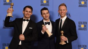 (L-R) Songwriters Benj Pasek, Justin Hurwitz and Justin Paul, winners of Best Original Song for 'City of Stars' from 'La La Land,' at the 74th Annual Golden Globe Awards yesterday. Getty Images