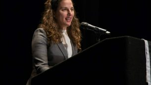 Rabbi Lila Kagedan, the first Orthodox clergy member to assume the title 'rabbi' in 2016, addresses the audience at the JOFA conference. Courtesy of JOFA.