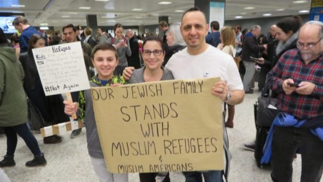 Jacob, left, Miri and Tal Zlotnitsky holding up a poster welcoming Muslim arrivals at Dulles International Airport in Virginia, Jan. 28 2017. JTA