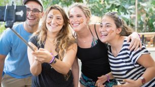 Participants in Through the Lens explore Israel through food and photography. Courtesy of Coby Engelhart