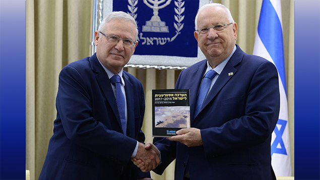 Amos Yadlin, left, the chairman of the Institute for National Security Studies, presents Israeli President Reuven Rivlin with the 2017 strategic assessment at the president's residence in Jerusalem on January 2. (Mark Neyman/Israeli Government Press Office)