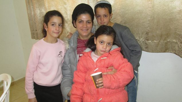 Shani Hamo and her three children, Roni, 7, Hallel, 4 and Dvir, 9, were evacuated from the Jewish settlement outpost of Amona.