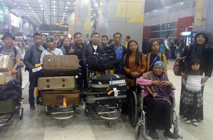 "Members of the ""Bnei Menashe"" Jewish community at the Indira Gandhi International Airport in New Delhi, India, en route to Israel, Feb. 13, 2017. (Shavei Israel)"