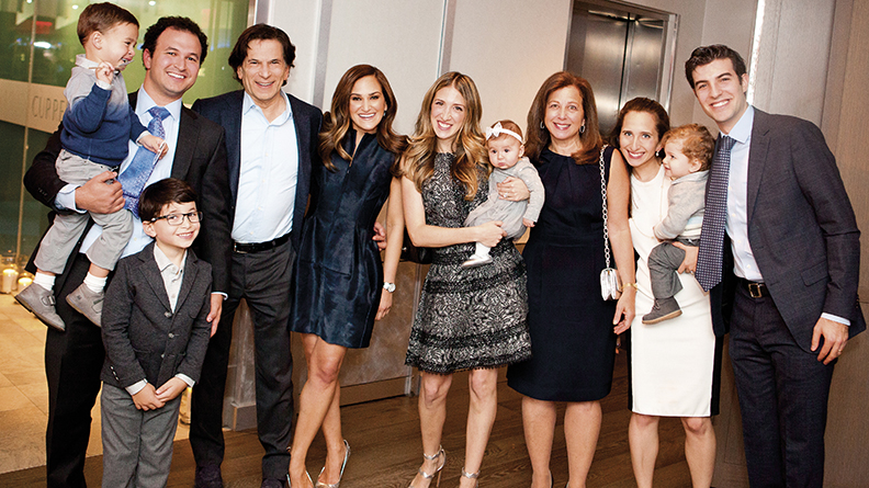 The Strauses celebrate Daniel's 60th birthday together; from left, Charlie, in Joseph's arms; Daniel; Lizzy; Diana, holding Gwen; Joyce; Julia Straus-Baruch, holding her son, Jacob; and David Baruch. Jack Strauss is in front of Joseph. Charlie and Gwen are Joseph and Diana's children, Jacob is Julia and David's son, and Jack is Lizzie's son.