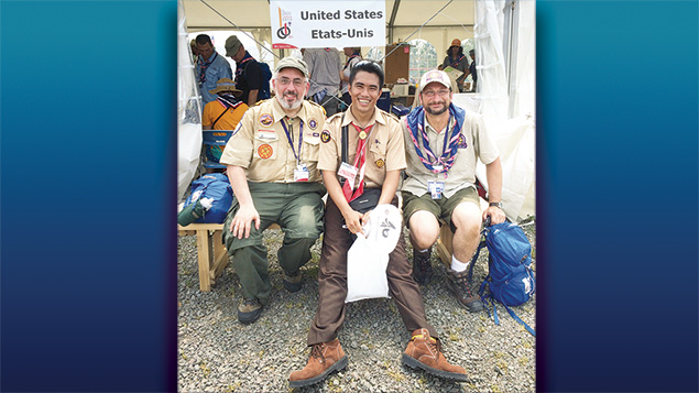 In the International Jamboree in Japan, an Indonesian scout is flanked by Joseph Prouser, left, and Archpriest Eric Tosi, national chaplain for Christian Orthodox scouts.