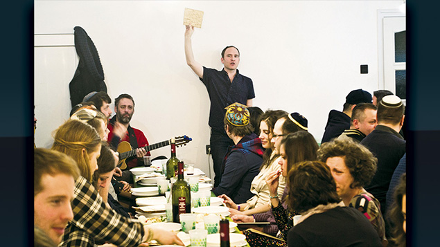 Adam Schonberger, standing, joins other participants in 2016 at the seder at the Aurora Jewish community center in Budapest. (Courtesy of Marom)