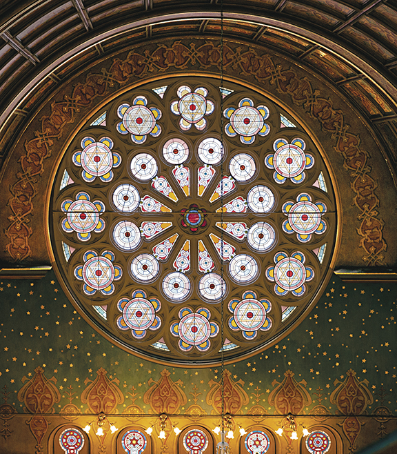 This rose window, at the back of the sanctuary, is part of the original building. (Neil Lawner)
