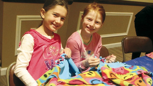 To earn letters in a Torah scroll, children make blankets for sick kids.