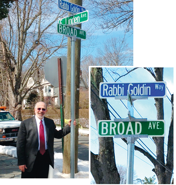 The city of Englewood has named the stretch of Broad Avenue that runs alongside Congregation Ahavath Torah to honor Shmuel Goldin.