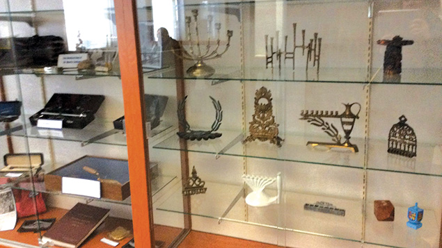 Display cases at the Jewish Historical Society of North Jersey hold treasured Judaica from area residents.