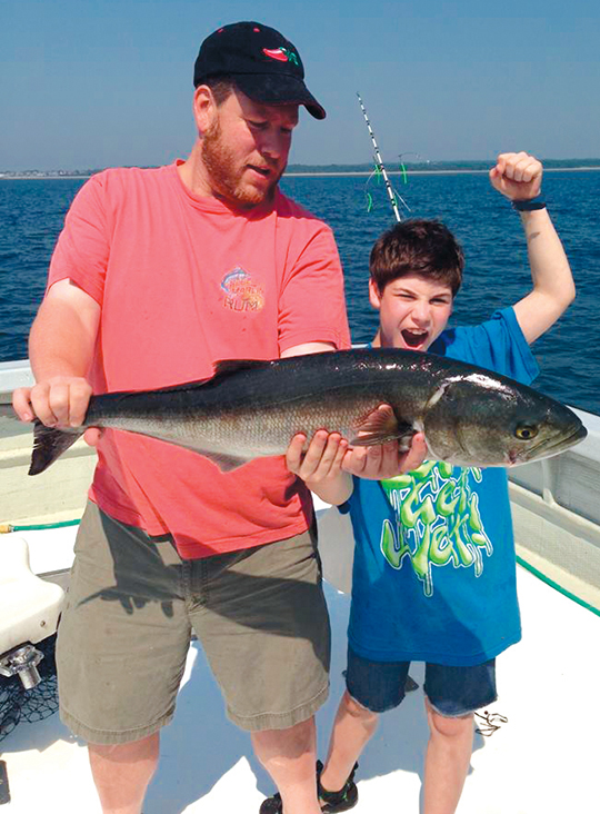 Jeff and Yonah Ingber hold another fish.