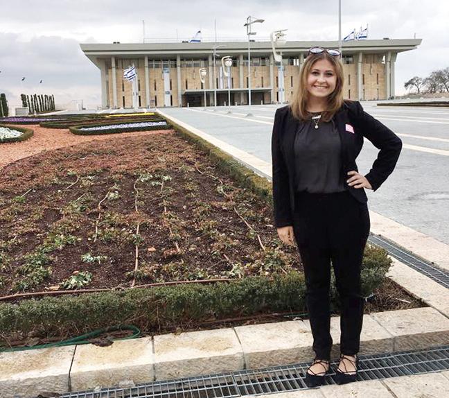 On an AIPAC trip, Ariela Rifkin stands outside the Israeli Parliament.