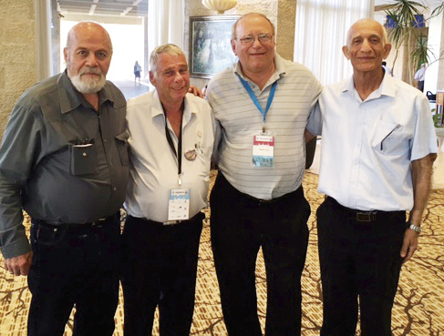 Fifty years later, the same soldiers — from left, Tzion Karasenti, Yitzhak Yifat and Chaim Oshri — stand with Siggy Fried (in the striped shirt, second from the right.)