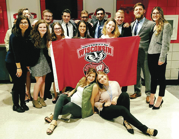 Ariela and other Jewish Badgers pose with the school banner.