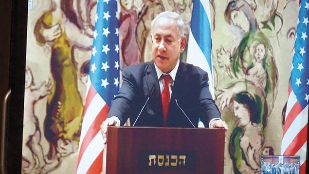 Prime Minister Benjamin Netanyahu addresses the global webcast from the Knesset in Jerusalem.