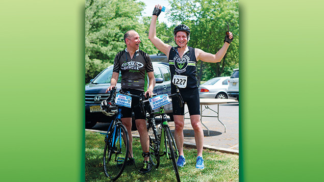 """They made it! Jerry watches as Jamie """"rehydrates"""" after the race."""