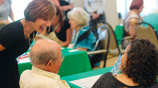Carol Silver Elliott, at left, talks to residents and visitors at the Jewish Home Assisted Living in River Vale.
