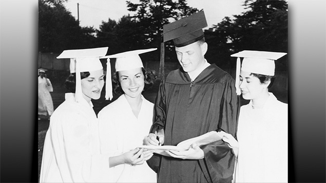 Larry Goodman signs his Passaic High yearbook for his future wife, Roz Charish, second from left, as two classmates join them at graduation ceremonies in 1957.